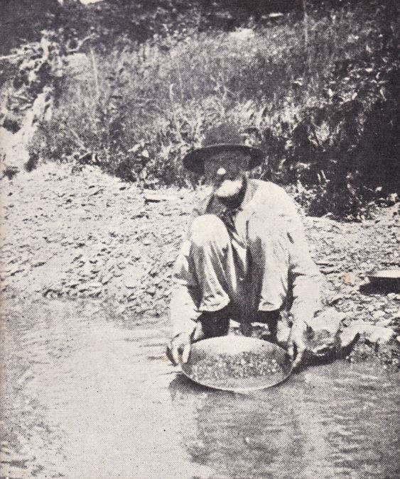 John Merriman panning for gold