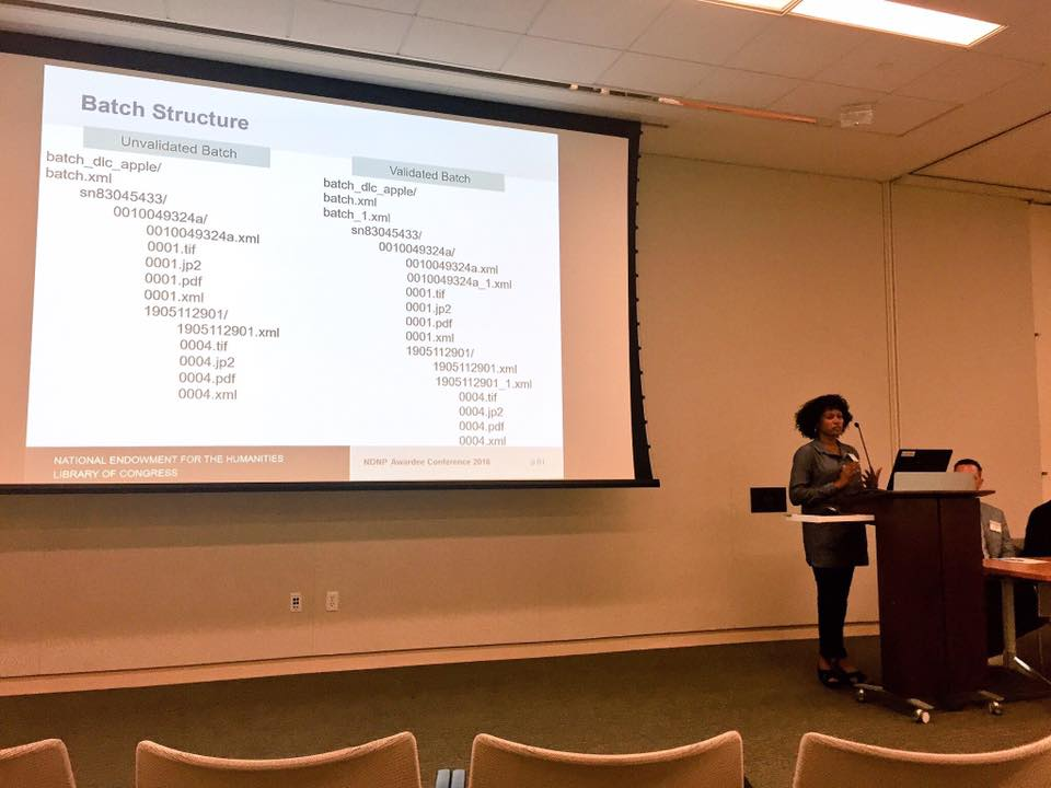 Leaning about the technical specifications for the NDNP with Tonijala Penn from the Library of Congress. Courtesy of Justin Clark.