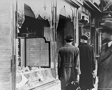 """Shattered storefront of a Jewish-owned shop destroyed during Kristallnacht,"" photograph, November 10, 1938, National Archives and Records Administration, accessed United States Holocaust Memorial Museum."