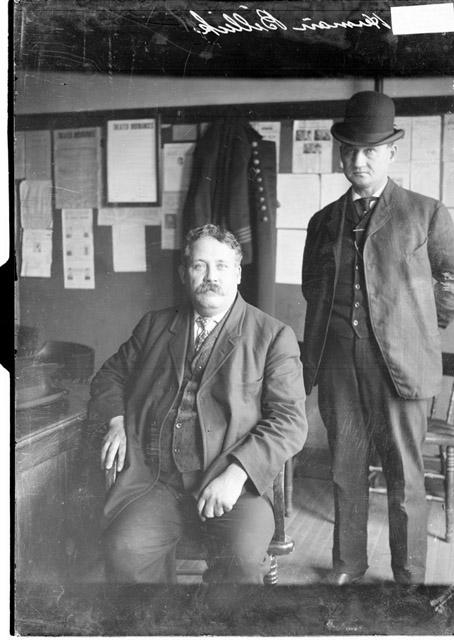 Chicago Daily News Photograph, circa 1906, accessed Chicago History Museum. Collection caption: Three-quarter length portrait of Herman Billick, Sr., who was suspected of poisoning members of the Martin Vrzal family, sitting in a room in the Hyde Park police station in the Hyde Park community area of Chicago, Illinois.