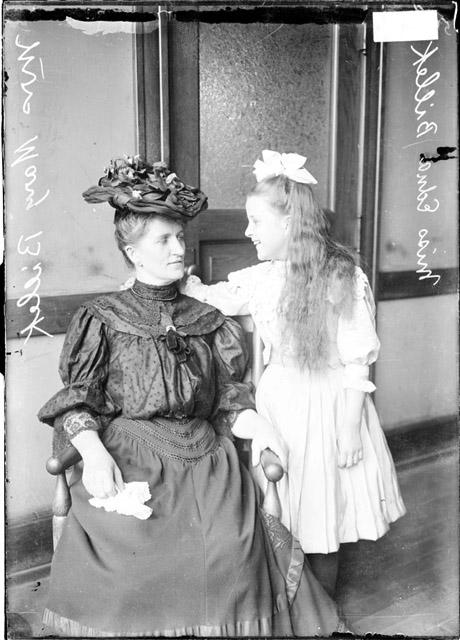 Chicago Daily News Photograph, circa 1907, accessed Chicago History Museum. Collection caption: [Mrs. Mary Billick, sitting, and Edna Billick, standing, looking at each other.